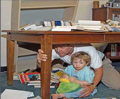 Picture of parent with child underneath a table