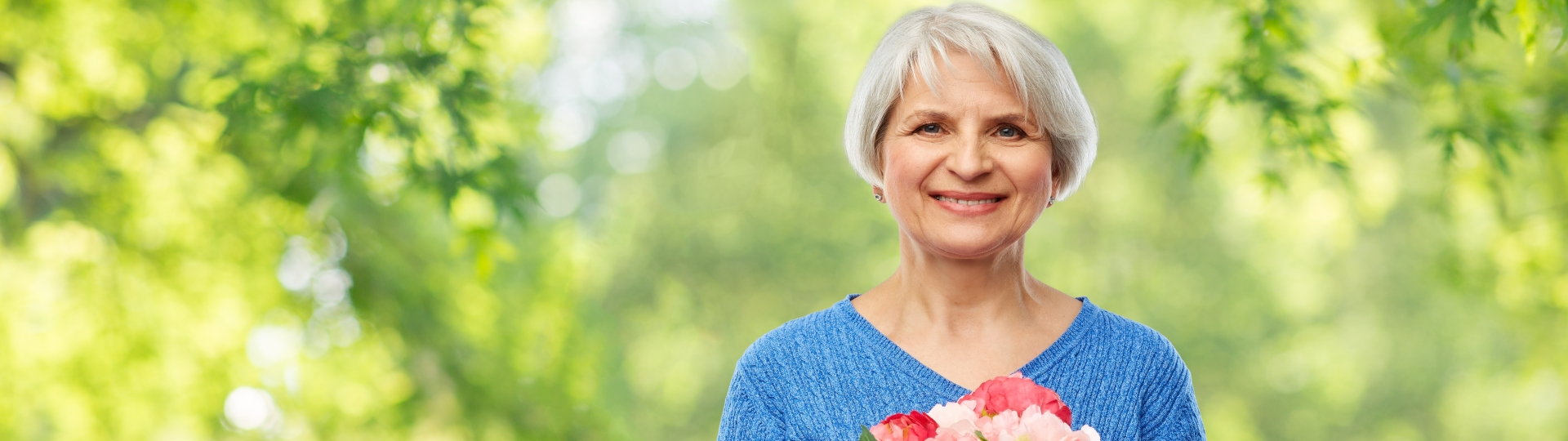 Elderly Woman Holding Roses